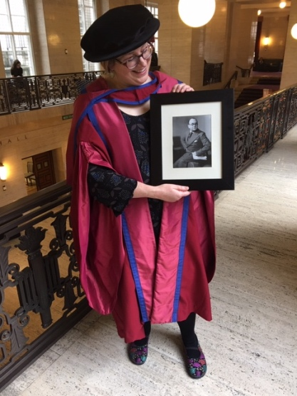 Lucie with picture of Maurice Elvey at her PhD graduation