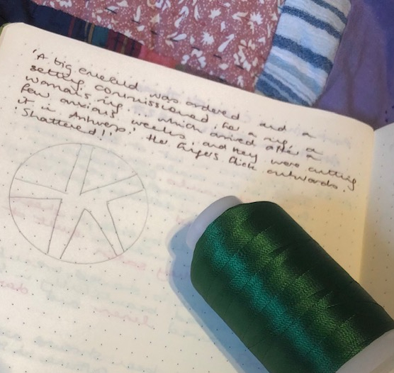 Green thread, a notebook, containing a sketch for a quilting design